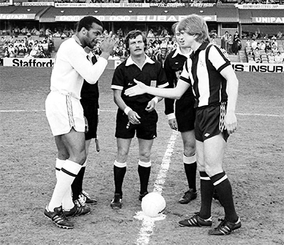 Len Cantello shakes hands with his opposing captain Cyrille Regis at The Hawthorns in 1979. The game ended 3-2 to Regis's side. Photograph: Laurie Rampling/BBC/Sugar Films