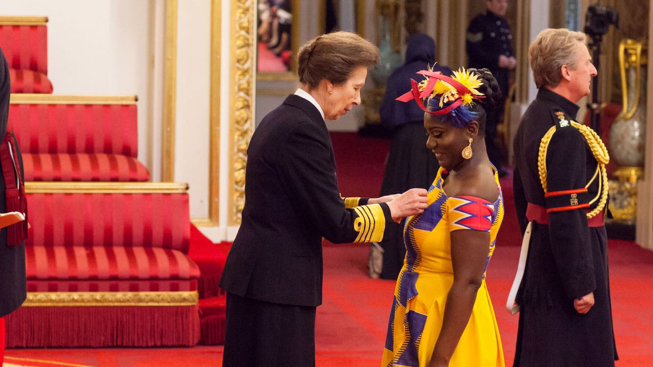 Princess Anne, awarding Dentaa her MBE