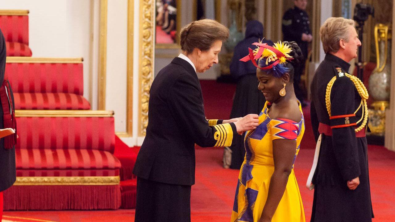 Princess Anne, awarding Dentaa her MBE