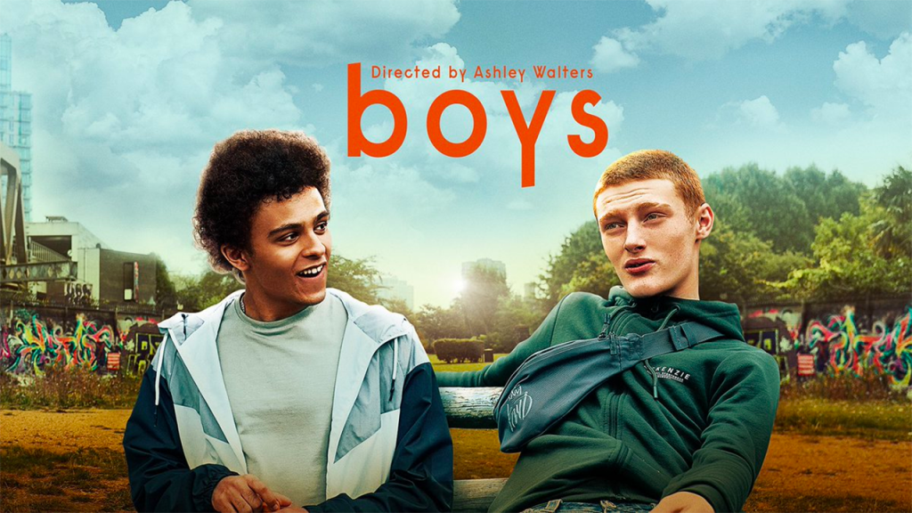 The Boys, Sky Arts. Image features Jude Chinchen and Hector Abbott as Lewis and Noah sitting on a bench – Lewis is looking at Noah and Noah looking straight on.